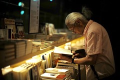 """""""Knowledge is power"""" (jaxting) Tags: jaxting bookstore e58 street people candid 東京 tokyo noctilux leica"""