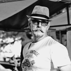 The Man (d_t_vos) Tags: man oldman hat glasses sunglasses moustache face vintage shirt outside outdoor street streetphotography streetportrait festival uitfestival leeuwarden prinsentuin groeneweg contrast dof people male macho square squared candid eyecontact watch watching watchingme contact dickvos dtvos