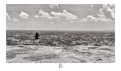 The view (krishartsphotography) Tags: krishnansrinivasan krishnan srinivasan krish arts photography monochrome fineart fine art view girl kid child shoe hill top city scape cloud clouds sky horizon line buildings houses trees rock day fort affinity photo dindigul tamilnadu india