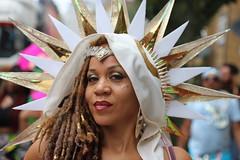 golden star (Chuck Diesel) Tags: nottinghillcarnival2018 london parade masquerader people greeneyes highyellow redbone sunrays blondedreadlocks dreads longhair portrait costume