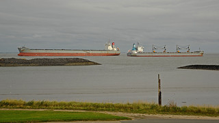 Tanker and freighter passing on the river Elbe near Cuxhaven-Döse