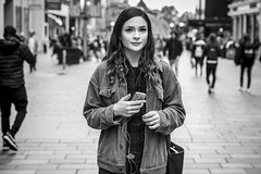 Bright Eyed and Bushy Tailed (Leanne Boulton) Tags: portrait people urban street candid portraiture streetphotography candidstreetphotography candidportrait streetportrait eyecontact candideyecontact streetlife woman female girl face pretty eyes expression mood feeling atmosphere beauty beautiful brunette earphones tone texture detail depthoffield bokeh naturallight outdoor light shade city scene human life living humanity society culture lifestyle canon canon5dmkiii 70mm ef2470mmf28liiusm black white blackwhite bw mono blackandwhite monochrome glasgow scotland uk