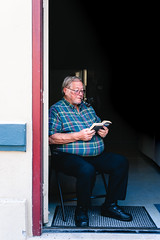 man reading (maywu_photography) Tags: portrait smoke people streetphotography reading book