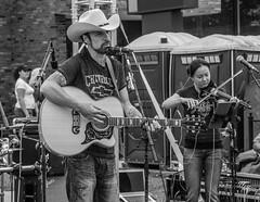 Country Guitar and Fiddle (John Kocijanski) Tags: hat band guitar guitarist people blackandwhite violin music musician streetphotography streetcandid streetfair