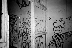 Scribbles II (esmeelily) Tags: 35mm film analog lomo lomography grain ilford black white is dead urbex derelict abandoned building raf upwood graffiti spraypaint street art vandalism tag tagging olympus trip af 50