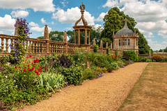 Montacute House flower garden border (Keith in Exeter) Tags: montacutehouse garden somerset nationaltrust herbaceous border flower wall balustrade pavillion architecture building ornate design path grass tree landscape vista sky montacute