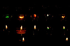 In cerca di luce perenne / In search of eternal light (Loredana Consoli) Tags: church light candele candle colours flame brittany bretagna france rochenfortenterre