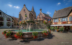 Eguisheim 2018 (EBoss Fotografie) Tags: eguisheim alsace france color painting church architecture square town street fountain sky clouds canon house ancient soe supershot