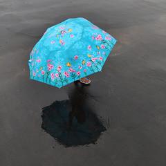 Umbrella (SaumalyaGhosh.com) Tags: umbrella kid feet small big contrast wet floor reflection color colour india kolkata street streetphotography