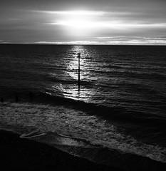 Black and white beach sunrise (Hammerhead27) Tags: olympus bw mono monochrome grey blackandwhite sun sky dawn sunrise teignmouth england devon coast sea waves water beach