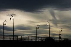 dusk (EllaH52) Tags: bridge streetlights lampposts dusk evening clouds car railing