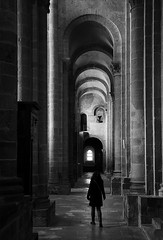 (cherco) Tags: lonely alone woman church archs blackandwhite blancoynegro iglesia girl black canoneos5diii canon city cold repeticion repetition puerta door person silhouette mystery columns columna solitario francia france cathedral tetrico