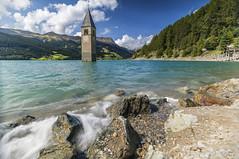 Reschensee (manuel.thaler) Tags: idyllic rocky waterfront lake reschensee church alps italy lago di resia südtirol south tyrol passo reschenpass