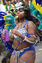 DSC_7733 Notting Hill Caribbean Carnival London Exotic Colourful Yellow Turquoise Silver and Blue Costume with Feather Headdress Girls Dancing Showgirl Performers Aug 27 2018 Stunning Ladies (photographer695) Tags: notting hill caribbean carnival london exotic colourful costume girls dancing showgirl performers aug 27 2018 stunning ladies yellow turquoise silver blue with feather headdress