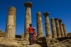 looking back at history (photoautomotive) Tags: sicily italy agrigento valleyofthetemples europe greek history historic old outside outdoor temple temples columns greekcolumns lookingback kids children child people bluesky stones canon 7d 1740l templeofheracles