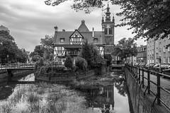 From the Bridge of Love, Gdańsk (Giovanni Piero Pellegrini) Tags: town building exterior bridge city canal architecture pedestrian cityscape arch old tower townscape most milosci kanal raduni milosc gdansk danzig danzica black white