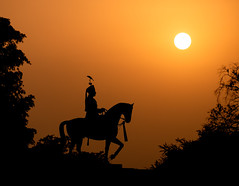 Ride off into the sunset (ajecaldwell11) Tags: orange xe3 sun statue silhouette sunset ankh india bird mansingh sky dusk jaipur caldwell fujifilm light