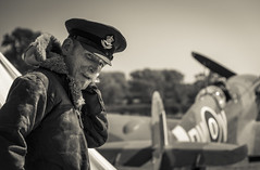 Spitfire at The Victory Show 2018 (John__Hull) Tags: victory show cosby leicestershire reenactment war recreation pilot spitfire mk vc ee602 black white uk england world 2 warplane plane prop propeller portrait nikon d7200
