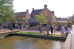 Bourton-on-the-Water, Cotswolds, England (Minoltakid) Tags: bourtononthewater cotswolds england buildings building people streetphotography river riverwindrush summer relaxing chilling thecroft bridge fun outside 2018 theminoltakid minoltakid rossdevans rossevans sony rx0 sonyrx0 village villagephotography villagephotograph photograph photo flickr day tagged weather sunnyday sunny tree peoplehavingfun cotswoldvillage summer2018 uk unitedkingdom greatbritain f4 vernes restaurant eatingplace popularvillage touristattraction englishvillage historicvillage historic popular old