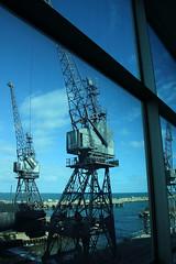 Blue cranes (Paul Threlfall) Tags: submarine hmasovens cranes throughawindow blue bluecast old grey navy royalaustraliannavy ran sky ocean indianocean fremantle wa westernaustralia perth