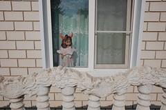 devil doll (streetphotodog) Tags: street colour color city streetphotography colourstreetphotography fujifilmx70 x70 russia devil doll horns