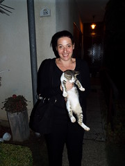 Here kitty kitty.... (sean and nina) Tags: nina evening night time outdoor outside dark kitty cat pussy legs arms stray hand bag black clothes smile smiling happy pose posed posing croatia serb croatian summer 2018 face brown eyes brunette gorgeous beauty beautiful stunning woman female girl lady girlfriend fiancee wife married balkan balkans europe european eu teeth dents august