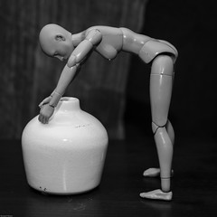 Hmmm... what's in here ? (N.the.Kudzu) Tags: tabletop stilllife vase plastic mannequin bw canondslr canoneflens lightroom