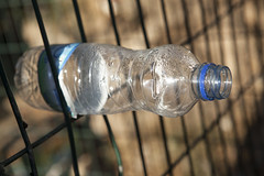 The Last Bottle Clings to the Net (zeevveez) Tags: zeevveez zeevbarkan canon זאבברקן bottle