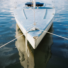 Abandoned sailboat (belousov.ph) Tags: mediumformat analog film kodak 120 zenzanon bronica light russia minimal atmospheric zenzanon80mm28 zenzanonps80mm square pool water abandoned boat sail mirror reflection ektar100 ektar