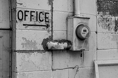 We'll leave the light on for you (hutchphotography2020) Tags: electricmeter cinderblocks office monochrome nikon
