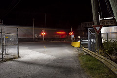 Crossing (Curtis Gregory Perry) Tags: princerupert britishcolumbia train crossing signal night longexposure red light fence road street ferry terminal nikon d810 yield sign canada motion blur rail railroad highway 16 yellowhead
