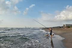 Los pescadores (Ksana But) Tags: sea beach coast child girl dog water ciel sky eau cloud childhood