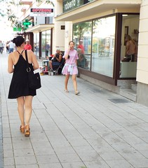 Nina - Out and about in Osijek, Croatia, August 2018 (sean and nina) Tags: nina osijek croatia croatian serb hrvatska eu europe european balkan balkans lbd little black dress photographer camera walking tourist tourism brunette sun glasses woman female girl lady girlfriend fiancee wife married beauty beautiful gorgeous stunning charm charming face candid outdoor outside street public tan skin bare arms pink lips brown eyes hair up legs sandals neck throat shoulders gold diamond necklace amazing incredible town shops pavement path buildings people persons