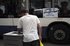 Land of milk and honey. Tel Aviv, May Day 2018. (joelschalit) Tags: israel telaviv palestine streetphotography pentaxkp flags documentary israeliflag zionism neoliberalism poverty inequality startupnation yomhaatzmaut