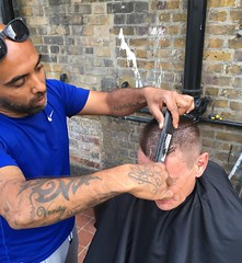 Nick cutting hair at a homeless shelter (WeAreBeam) Tags: nick barber