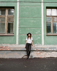 Kate and oldhouse (Alexander Kamnev) Tags: pretty atmosphere city oldcity outdoor girl filmscan light portrait kodak novosibirsk noritsu color pentax67 portra analog naturallight smcpentax10524 mediumformat kodakportra film melancholy 6x7 beautiful noon hat