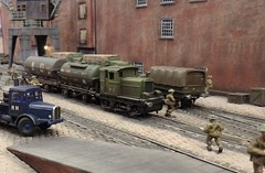 Shunting Amidst The Chaos of War. (ManOfYorkshire) Tags: wd wardepartment diesel loco locomotive engine 040 oil tankers wagons shunt shunting docks dockside quay quayside lorry soldiers ww2 worldwar2 fictitious railway train scale model layout 176 oogauge