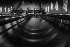 """""""I can see the runway clearly"""" / unusual angle in an ordinary setting (Özgür Gürgey) Tags: 24120mm bw d750 darkcity nikon arch architecture escalator grainy lines lowlight metal people reflection symmetry istanbul marmaray sirkeci station"""