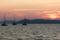 004 (JirkaVorel) Tags: italy sardinia sardegna sardigna alghero sunset sea water sky mountain boat catamaran