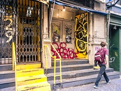 Yellow 3841 (Demmer S) Tags: street building streetphotography people pedestrian peoplewatching shootthestreet streetlife streetshots documentary citylife person urban city outside urbanphotography streetscene urbanexploration outdoors facade wallscape architecture architectural urbandetails steps doors windows signs signage words text lightbulb awning yellow letters numbers graffiti scribbles visual exterior surface marks writing scribbled scrawls scribbling scrawled markings doodles streetart graffitiart urbanart wallart streetartistry doodle drawing wall buildingart graffitiphotography nycgraffiti graffitiphotographer canalstreet chinatown lowermanhattan manhattan ny newyork nyc newyorkcity bw monochrome blackwhite blackandwhite