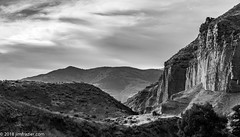 The Last Shot (Jim Frazier) Tags: 2018 201807montana 201807yellowstone 3d3layer bw beautiful beauty blackandwhite bluesky cliffs cliffside desaturated geology jimfraziercom july landscape monochrome mountains mountainsides nationalpark nationalparkservice nationalparks natural nature nps parks q4 rock rockymountains scenery scenic stone summer sunny vacation wyoming yellowstone jfpblog f10 fastpictures instagram f20 leadinglines converginglines