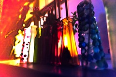 Bottles by Window (a2roland) Tags: normanzeba2rolandyahoocom multicolored window bottles streetlight back lit red blue green orange color frame background bokeh glow