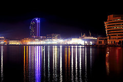 When lights invite to shoot (Fnikos) Tags: port puerto porto harbour harbor sea water waterfront sky skyline architecture building tower light reflection night nightview nightshot outdoor