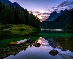 Between the Darkness and the Light (b.adolphi) Tags: mountain lake reflection sunrise stones trees water purple green switzerland graubünden bergün preda laidapalpuogna palpuognasee