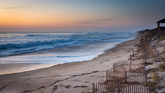 Sunrise on the Outer Banks (Bruce Bugbee) Tags: nagshead northcarolina unitedstates us obx outerbanks ocean waves sunrise water sand beach fence sky sea