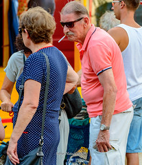 You saw my lighter? (Robica Photography) Tags: robicaphotography d3200 2018 streetphotography straatfotografie tilburg people faces funfair fair amusement detilburgsekermis man woman couple colourful cigarette lighter searching seeking sunglasses standing asking expression purse