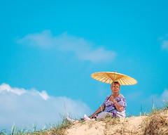 Sun shading. (James- Burke) Tags: crosby crosbybeach beach sunbathing merseyside sunshades woman sky tallships lady liverpool sanddunes