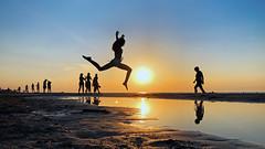Fly (p!o) Tags: cinematography sixteenbynine 169 jump sunset tramonto silhouette summer beach sea kids backlight iphone torremileto sannicandro sannicandrogarganico puglia gargano