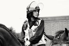 Kicking off. (ianmiller6771) Tags: mountedpolicewoman policehorses streetphotographyuk ukstreetphotography streetphotography bw blackandwhite monochrome disturbance concern candid worcesteruk fujixt1 disorder