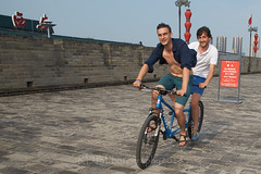 2018 Xi'an - On and Around the Old City Walls 67 (C & R Driver-Burgess) Tags: xian 西安 wall city towers ancient historical stone defense tourist tandem cyclists man men two pair couple blue shirt open bare chest smile moustache sandals shorts